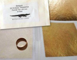 листы сусального золота и кольцо